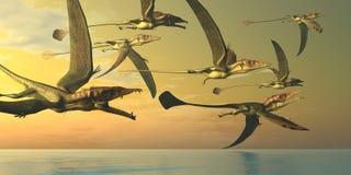 Eudimorphodon Dinosaur Flock. A flock of Eudimorphodon flying reptiles search for fish prey in the Triassic Era Royalty Free Stock Photography