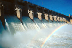 Eufaula Dam. Spillway with the floodgates open and roaring and a double rainbow in the mist royalty free stock images