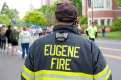 Eugene Fire Marshall Eugene, OR. Eugene, OR, USA - April 28, 2013: Eugene Fire marshall overlooks runners at the start of the Eugene Marathon. The Eugene Royalty Free Stock Photos