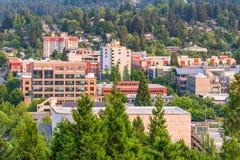 Eugene, Oregon, USA Skyline at Dusk. Eugene, Oregon, USA downtown cityscape at dusk amongst the trees stock images