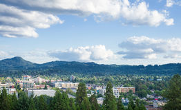 Eugene Summer Skyline. Eugene, Oregon skyline under a blue summer sky dotted with clouds taken from Skinner's Butte royalty free stock photos