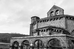 Eunate by the mountain in black and white. 12th century Romanesque church located in the North of Spain which origin remains controversial Royalty Free Stock Images