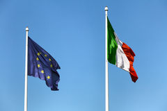 Euopean and italian flags. On the sky Royalty Free Stock Photo