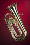 Euphonium basso del Tuba isolato su colore rosso Fotografie Stock Libere da Diritti