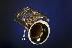 Euphonium de la tuba aislado en azul Imagen de archivo libre de regalías