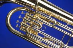 Euphonium de la tuba aislado en azul Fotos de archivo libres de regalías