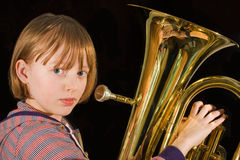 Euphonium player. Girl ready to give a blast on the euphonium Stock Photography