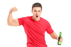 Euphoric fan holding a beer bottle and cheering Stock Image