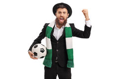 Euphoric football fan with a scarf cheering Stock Photography
