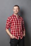 Euphoric 40's man smiling with a cool attitude Royalty Free Stock Photos