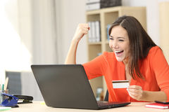 Euphoric shopper buying online Stock Photography