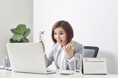 Euphoric and surprised winner online watching a laptop at office, Beautiful young woman glad and surprised after open email on stock images