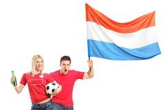 Euphoric ventilator för manlig och för kvinnlig med den holländska flaggan Royaltyfri Bild