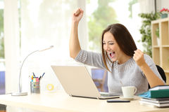 Euphoric winner winning at home Stock Photography