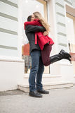 Euphoric young couple meeting and hugging on the street. royalty free stock images