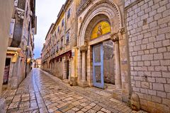 Euphrasian Basilica gate and Porec stone street view. UNESCO world heritage site in Istria, Croatia Royalty Free Stock Images