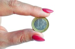 Euro coin in fingers stock photos