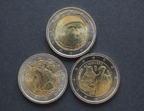 EUR coins with Italian writers. 2 EUR coins issued by Italy bearing the portrait of Italian writers: Dante Alighieri (1265-1321), twice, and Giovanni Boccaccio ( Stock Image
