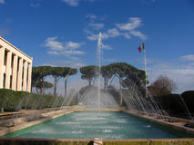 EUR Fountain. A fountain in the modern city of Romes EUR in Italy.  This suburb of Rome was developed under Mussolini's rule and never completely finished due to Stock Image