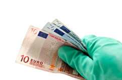 With EUR rubber glove. In closeup over white background Royalty Free Stock Photo
