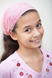 Eurasian girl in pink bandanna Stock Photography