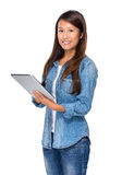Eurasian woman use digital tablet Royalty Free Stock Photo