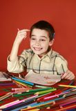 Eureca. Freckled boy musing and drawing, hit upon, come to mind royalty free stock images