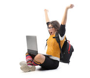 Eureka!. Triumphing student with a laptop on her knees Stock Image