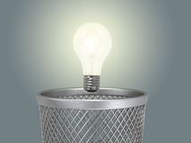 Eureka;. Concept of the reborn of idea;  glowing light bulb under the bin Stock Images