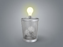 Eureka; concept of the reborn of idea. Glowing light bulb under the bin with other lamps Royalty Free Stock Photos