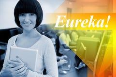 Eureka ! contre le professeur avec le PC de comprimé photo libre de droits