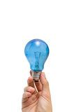 Eureka. A hand holding a blue lightbulb Royalty Free Stock Photos