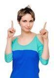 Eureka. Woman with an idea raising her finger royalty free stock photos