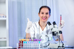 Eureka!!! Young scientist woman working at the laboratory Royalty Free Stock Photo