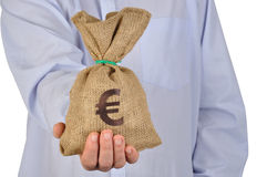 Euro. Man giving money bag with euro symbol Royalty Free Stock Photos