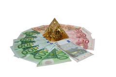 Euro. Money liing on circle and with pyramid in centre Royalty Free Stock Photography