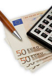 Euro 2. Currency calculator and pen in the same frame Royalty Free Stock Photography