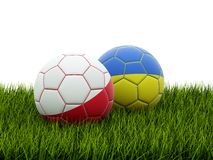EURO 2012 footballs. Isolated on grass Royalty Free Stock Photography