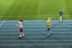 Euro 2012 mascots. KHARKIV, UKRAINE - SEPTEMBER 2, 2011: Euro 2012 mascots greet visitors at half-time of the football friendly match between national teams of Royalty Free Stock Photos