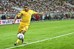 Euro 2012 Qualifying Round (Group D)Romania-France. Romanian player(Banel Nicolita) kicking the ball in the football match between Romania and France in the Euro Royalty Free Stock Photos