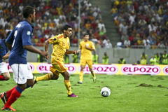 Euro 2012 Qualifying Round (Group D)Romania-France. Romanian player (Banel Nicolita) running with the ball in the football match between Romania and France in Stock Image