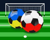 Euro 2012 Soccer Balls Background. Soccer balls with Poland and Ukraine flags colors in foreground and goal in background Stock Photos