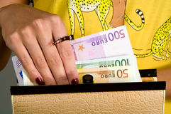 Euro. Woman gets euro from a purse Royalty Free Stock Image