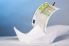 Euro. Symbolic picture with a paper boat and euro Royalty Free Stock Photos