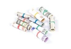 Euro acciambellato e fatture dolar Immagini Stock
