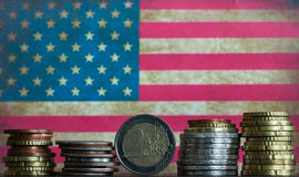 Euro and american coins American flag background Stock Image