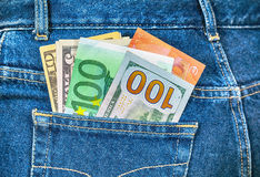 Euro and american currency, money in jeans pocket Royalty Free Stock Photography