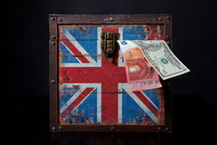 Euro and american dollar on British flag. Euro banknote and american dollar on British flag royalty free stock photo