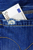 Euro in the back pocket of jeans Royalty Free Stock Image