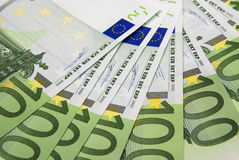 Euro background. Background from hundred euros of banknotes spread out by a fan Royalty Free Stock Photo